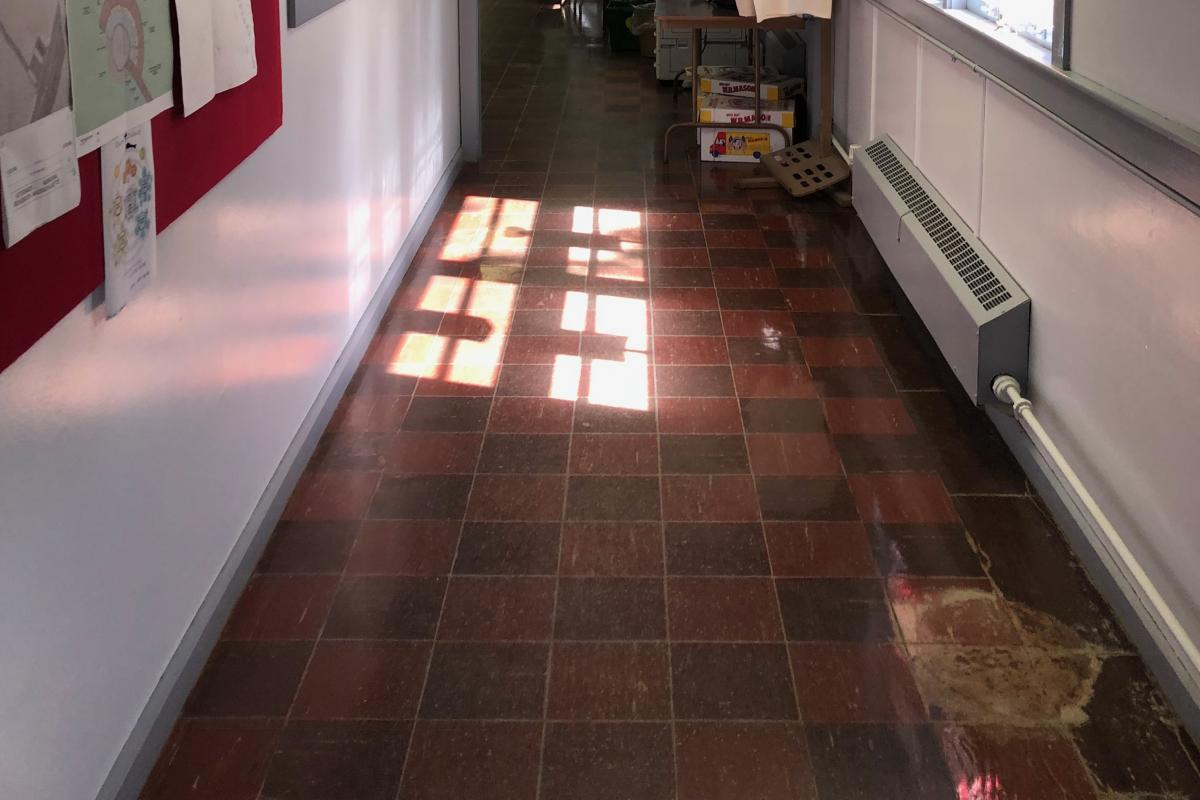 Damaged floor exposing asbestos